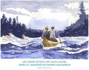 Un canoé atteint des eaux calmes après la traversée de rapides dangereux